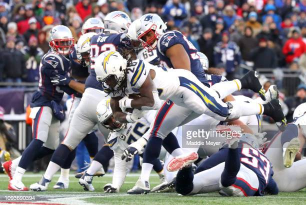 Melvin Gordon of the Los Angeles Chargers scores a touchdown during the third quarter in the AFC Divisional Playoff Game against the New England...