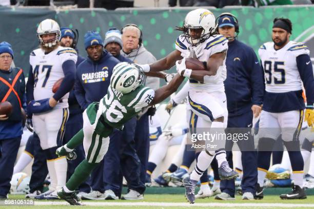 Melvin Gordon of the Los Angeles Chargers stiff arms Marcus Maye of the New York Jets during the second half of an NFL game at MetLife Stadium on...