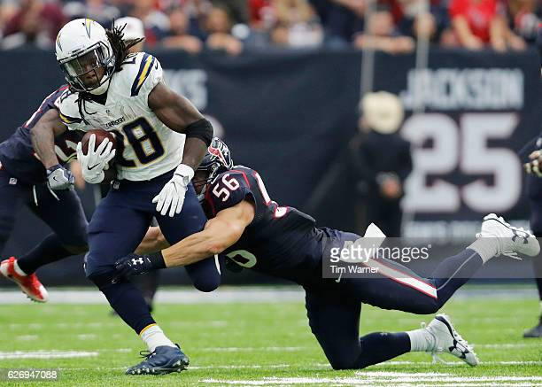 Melvin Gordon of the San Diego Chargers carries the ball in the fourth quarter as Brian Cushing of the Houston Texans attempts to make the tackle at...
