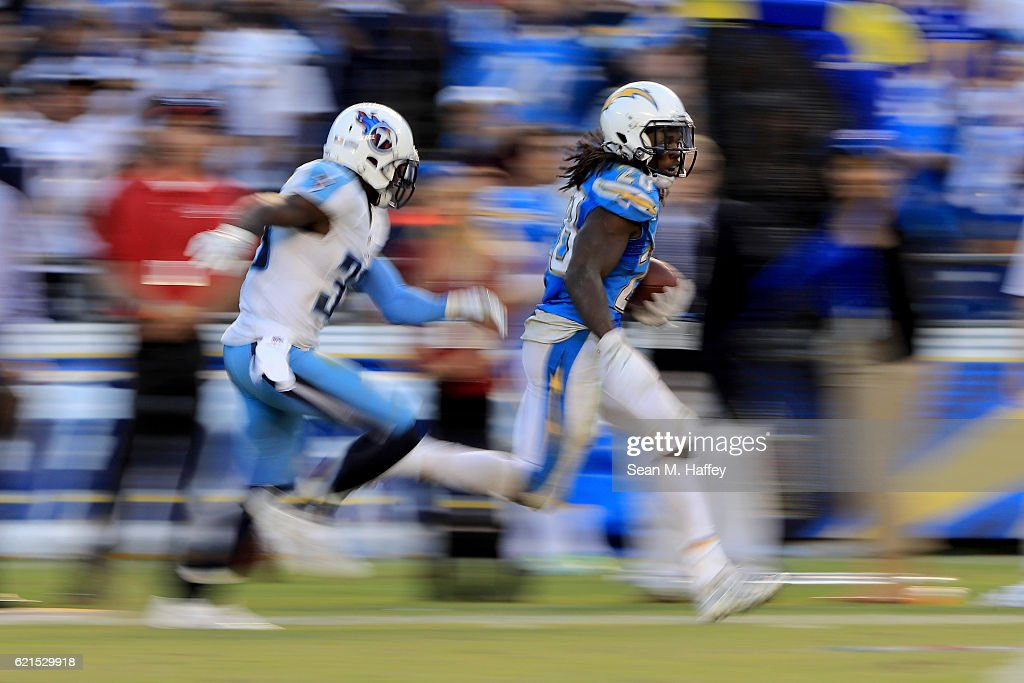 Melvin Gordon #28 of the San Diego Chargers eludes Jason McCourty #30 of the Tennessee Titans on a 35 yard pass play during the second half of a game at Qualcomm Stadium on November 6, 2016 in San Diego, California.