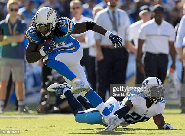 Melvin Gordon of the San Diego Chargers runs past Perrish Cox of the Tennessee Titans in the first half at Qualcomm Stadium on November 6 2016 in San...