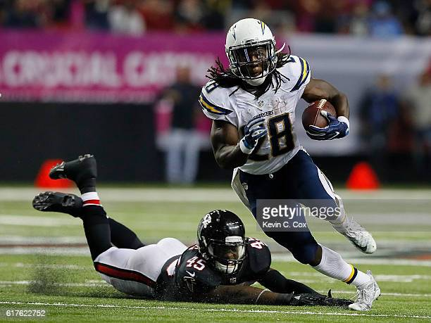 Melvin Gordon of the San Diego Chargers rushes away from Deion Jones of the Atlanta Falcons at Georgia Dome on October 23 2016 in Atlanta Georgia