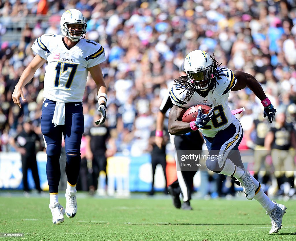Melvin Gordon #28 of the San Diego Chargers takes a handoff from Philip Rivers #17 during the second quarter against the New Orleans Saints at Qualcomm Stadium on October 2, 2016 in San Diego, California.