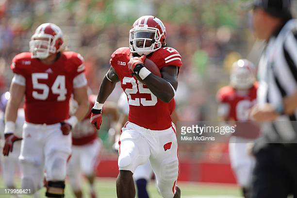 Melvin Gordon of the Wisconsin Badgers runs for 65 yards during the first half against the Tennessee Tech Golden Eagles at Camp Randall Stadium on...