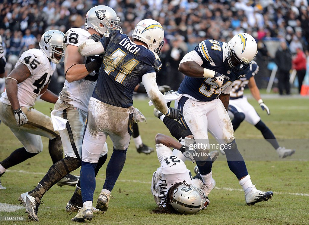 Melvin Ingram #54 of the San Diego Chargers hits Coye Francies #31 of the Oakland Raiders to the ground off of a kickoff return during a 24-21 win at Qualcomm Stadium on December 30, 2012 in San Diego, California.