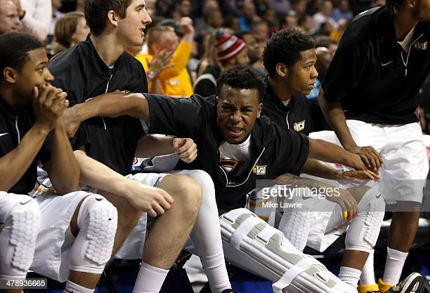 Melvin Johnson of the Virginia Commonwealth Rams celebrates in a knee brace with teammates in the second half after sustaining an injury in the first...