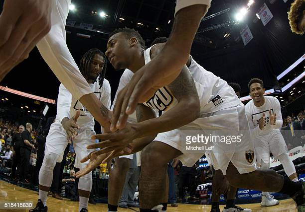 Melvin Johnson of the Virginia Commonwealth Rams walks out of the huddle prior to the game against the Saint Joseph's Hawks in the championship game...