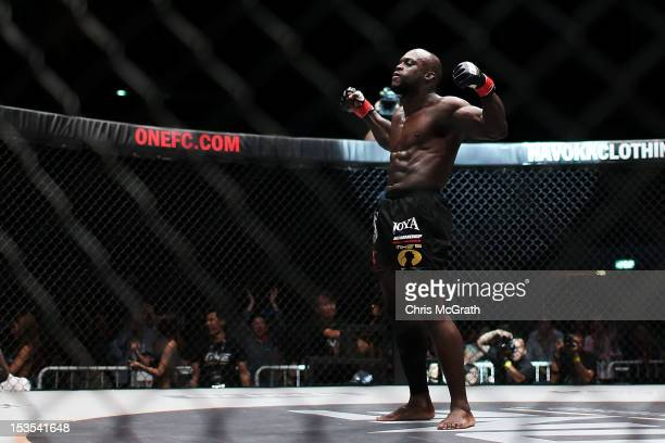 Melvin Manhoef of the Netherlands celebrates victory over Ryo Kawamura of Japan during the One Fighting Championship, at Singapore Indoor Stadium on...