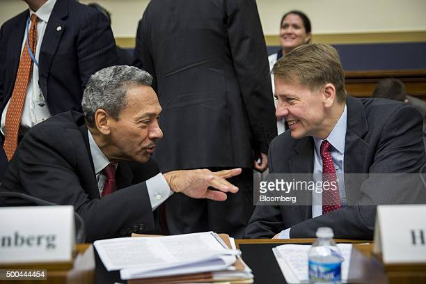 Melvin 'Mel' Watt director of the Federal Housing Finance Agency left speaks with Richard Cordray director of the Consumer Financial Protection...