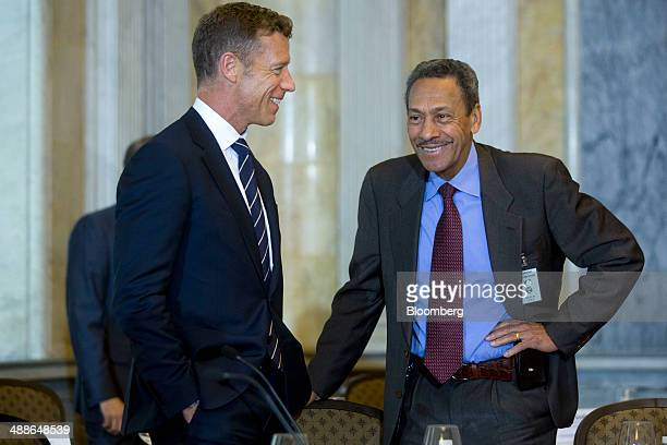 Melvin Mel Watt director of the Federal Housing Finance Agency right and Michael McRaith director of the federal insurance office at the US Treasury...