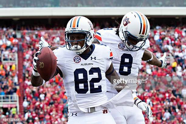 Melvin Ray celebrates with Tony Stevens of the Auburn Tigers after scoring a touchdown against the Arkansas Razorbacks at Razorback Stadium Stadium...