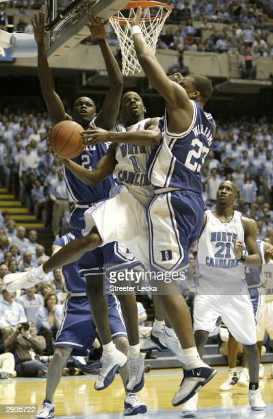 Melvin Scott of the University of North Carolina Tar Heels drives for a shot attempt against Luol Deng and Shelden Williams of the Duke Blue Devils...