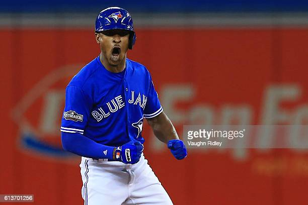 Melvin Upton Jr #7 of the Toronto Blue Jays celebrates after hitting a double against the Texas Rangers in the sixth inning during game three of the...