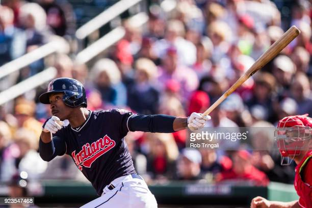 Melvin Upton Jr of the Cleveland Indians singles against the Cincinnati Reds during a Spring Training Game at Goodyear Ballpark on February 23 2018...