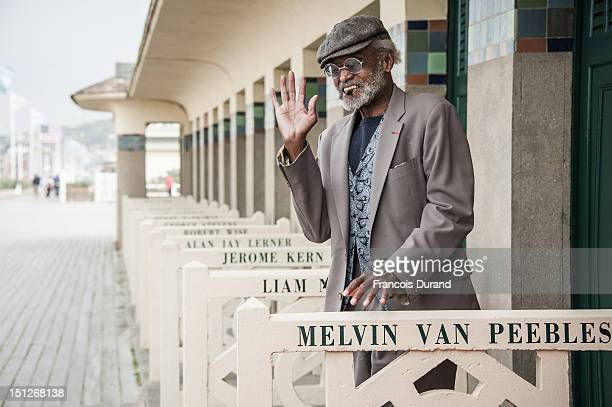 Melvin van Peebles poses next to the beach closet dedicated to him on the Promenade des Planches during the 38th Deauville American Film Festival on...