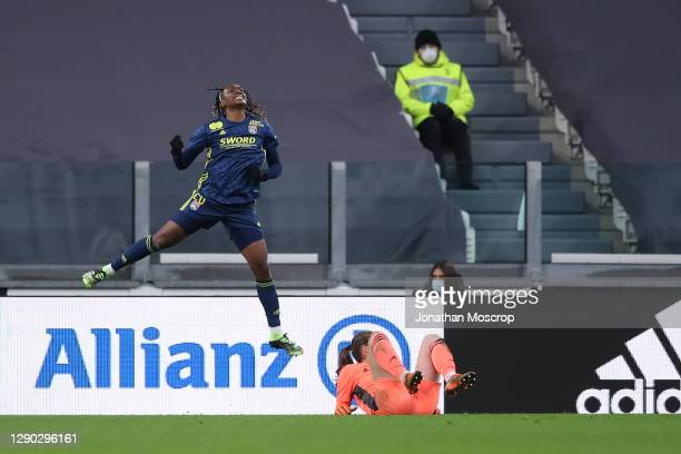 Melvine Malard of Lyon celebrates after scoring to level the game at 2-2 during the UEFA Women's Champions League round of 32 first leg match between...