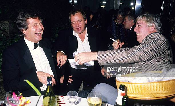 Melvyn Bragg Mel Smith and Peter Cook at first night party for musical 'Miss Saigon' London September 1989