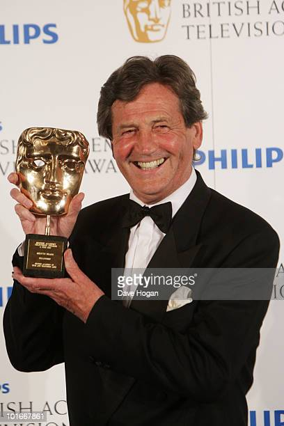 Melvyn Bragg poses with his Academy Fellowship award in front of the winners boards at The Philips British Academy Television Awards held at The...