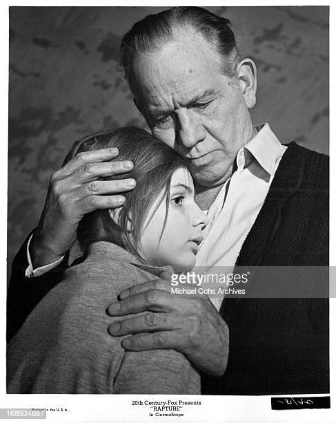 Melvyn Douglas comforts Patricia Gozzi in a scene from the film 'Rapture' 1965