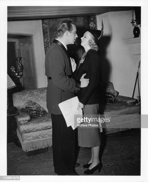 Melvyn Douglas whispers Do You Love Me while holding Virginia Bruce in a scene from the film 'Arsene Lupin Returns' 1938