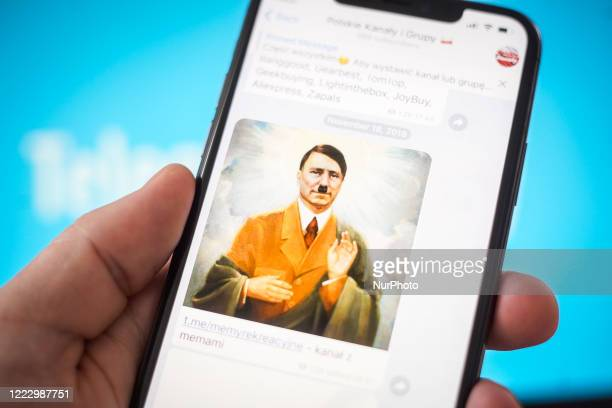 Mem depicting Hitler as a Jesus figure is seen on the Telegram cloud-based instant messaging application on an iPhone in this photo illustration on...