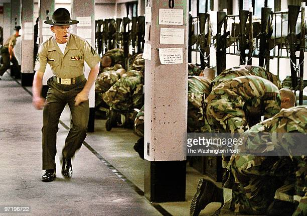 ME/marines Jahi Chikwendiu/TWP Sergeant David Grimes barks orders to new recruits during the ceremony where the recruits crossover from their...