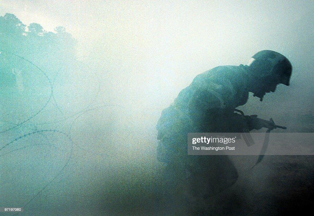 ME/marines 03/19/2002 A Marine recruit makes his way through : News Photo
