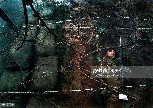 ME/marines Norton Pereira crosses beneath a wire fence during the Combat Assault Resupply Course of the Crucible at Marine boot camp on Parris Island...