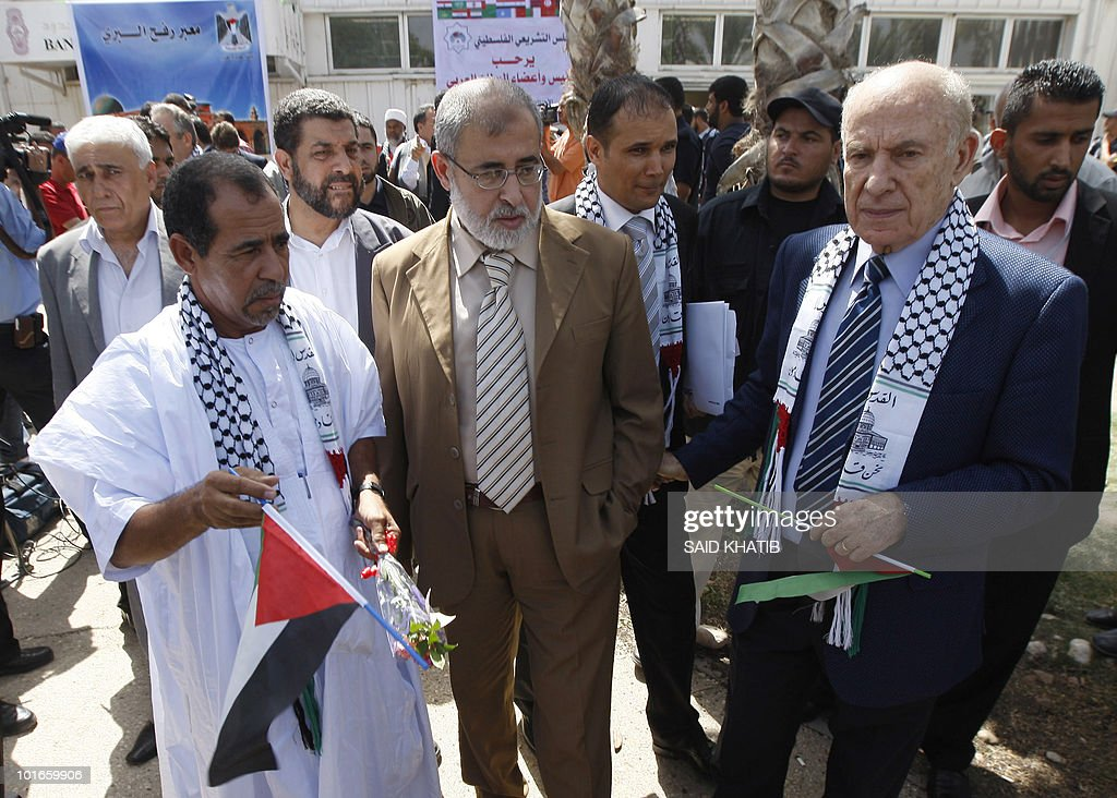 A 30 member Arab Parliament delegation are welcomed by representatives of the Islamic Hamas movement upon their arrival at the Rafah border crossing between the southern Gaza Strip and Egypt on June 06, 2010 where they arrived to express their solidarity with the Gaza population which has been under an Israeli blockade since Hamas seized control of the strip in June 2007.