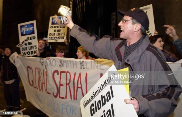 UP member Eric Sawyer and others demonstrate inside the lobby of the GlaxoSmithKline Investor Relations office building 20 February 2001 on Park...