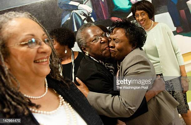 Member Evelyn J McReynolds center hugs founding member and vice chair of the foundation Maggalean Weston right On the left is Diana Abney member The...