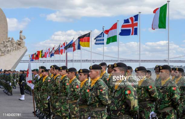 Member flags fly behind Army personnel during a ceremony staged by Portuguese Armed Forces near Padrão dos Descobrimentos monument by the Tagus River...