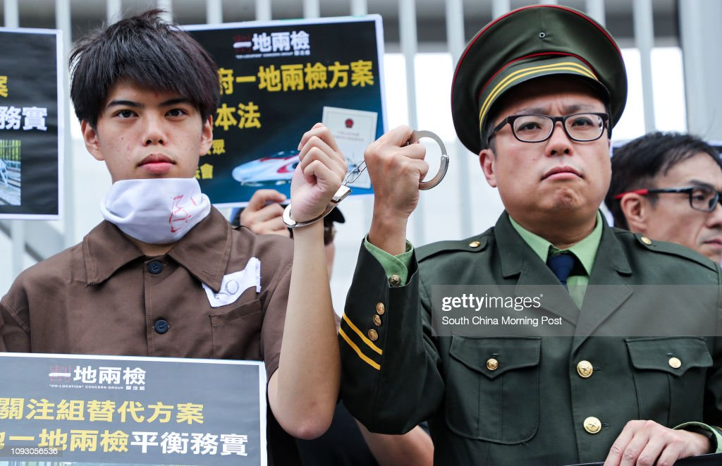 """Member from """"Co-location"""" Concern Group Tam Tak-chi (R) dresses as a PLA soldier during a protest during the MTR Express Rail Link (XRL) Train Open Day at the MTR Shek Kong Stabling Sidings in Yuen Long. 07OCT17 SCMP / Edward Wong : News Photo"""
