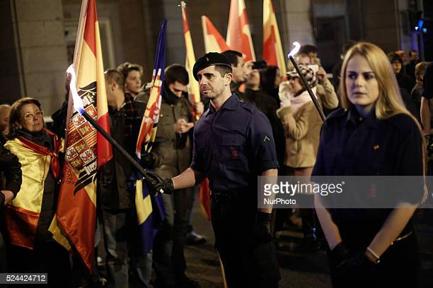 A member from la falange with a torch in his hands awaits to start the march to el valle de los caidos The march takes place from Madrid to the...