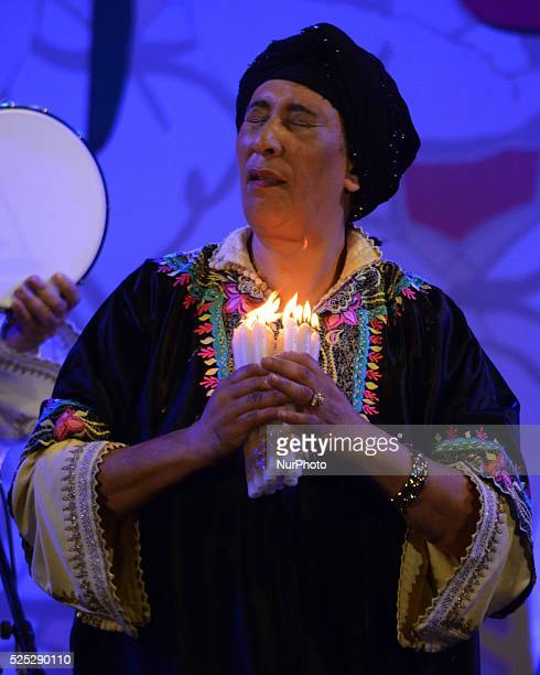Member from Moroccan Hadarrattes Souiriattes group perform with candle at the Sufi festival an International festival of Sufi and traditional music...