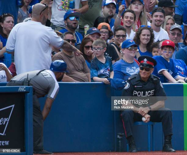 TPS member grabs his wrist after taking a hard shot on a foul ball from the bat of Toronto Blue Jays center fielder Kevin Pillar Toronto Blue Jays Vs...