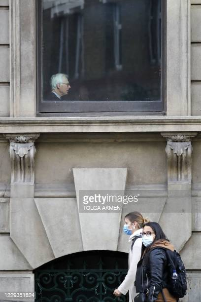 Member is pictured in the window of the private members' Garrick Club, founded in 1831 and situated in the heart of London's West End and...