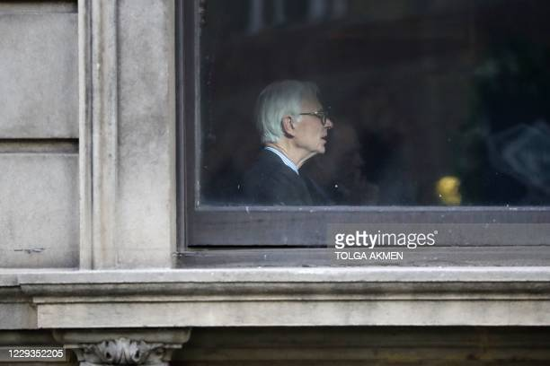 Member is seen through a window of the private members' Garrick Club, founded in 1831 and situated in the heart of London's West End and Theatreland,...