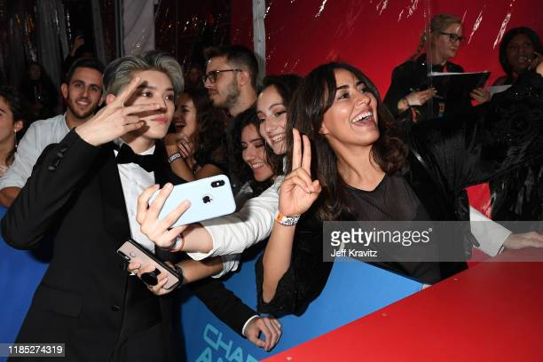 NCT 127 member Johnny takes selfies with fans during the MTV EMAs 2019 at FIBES Conference and Exhibition Centre on November 03 2019 in Seville Spain