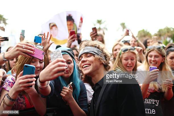 Member of 5 Seconds of Summer Ashton Irwin poses with fans at the 28th Annual ARIA Awards 2014 at the Star on November 26 2014 in Sydney Australia