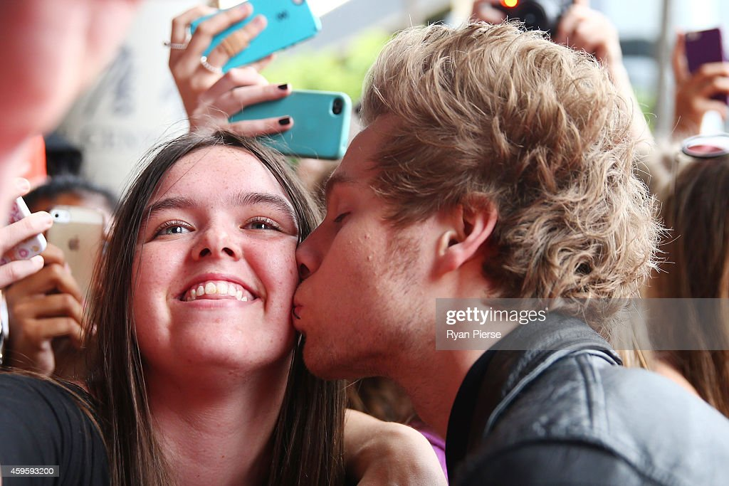 Member of 5 Seconds of Summer, Luke Hemmings kisses a fan at the 28th Annual ARIA Awards 2014 at the Star on November 26, 2014 in Sydney, Australia.