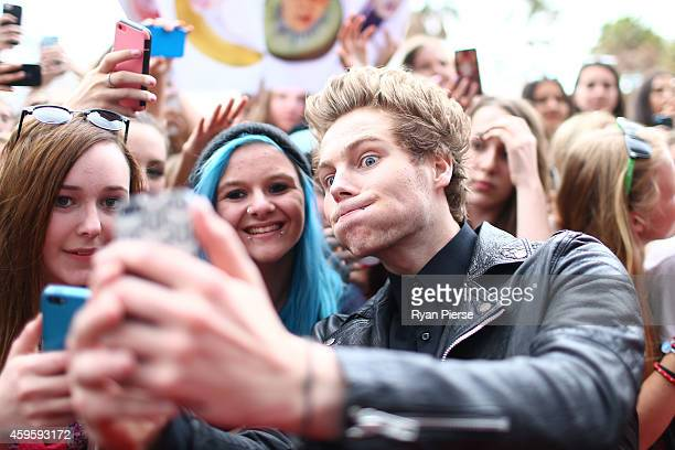 Member of 5 Seconds of Summer Luke Hemmings poses with fans at the 28th Annual ARIA Awards 2014 at the Star on November 26 2014 in Sydney Australia