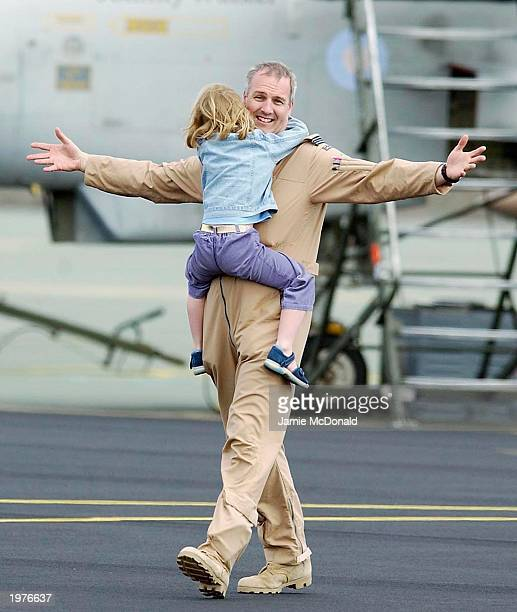 Member of 9 Squadron is reunited with his children after eleven Royal Air Force Tornado aircraft return to their home base of RAF Marham May 6, 2003...