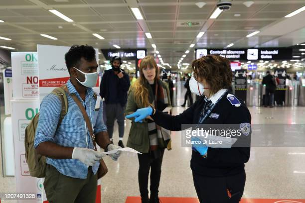 Member of a Bangladeshi family seeks help to an employee of ADR, Aeroporti di Roma, to fill out a self-certification that certifies their motivation...