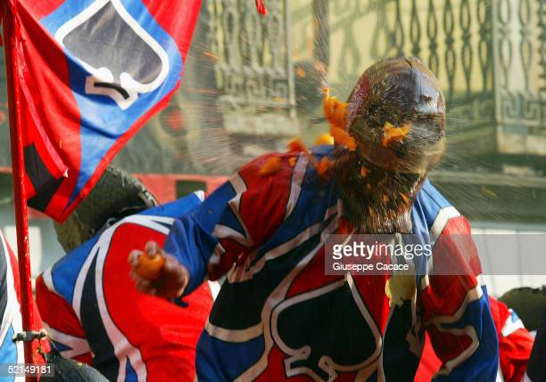 A member of a cart team is seen during the Orange Battle at the 2005 Ivrea Carnival on February 6 2005 in Ivrea Italy During the Orange Battle 3600...