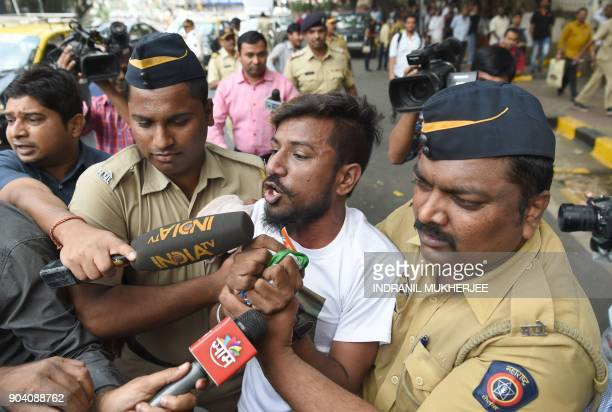A member of a castebased group Rajput Karni Sena is detained by the police during a demonstration against the Bollywood film 'Padmavati' outside the...
