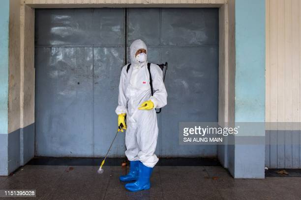 A member of a charity organisation wears a hazardous material suit during the funeral service of a person who died from the H1N1 influenza virus at...
