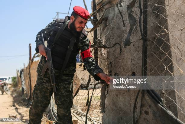 Member of a committee of Palestinian Legislative Council inspects the wire at the border in Gaza City Gaza on August 23 2017 A committee of...