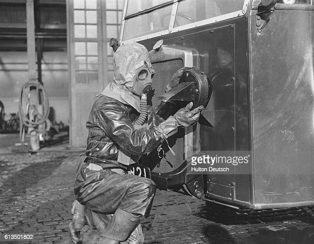 A member of a decontamination squad fixes a special light onto the front of a lorry which will patrol the streets of Leicester during a pratice...