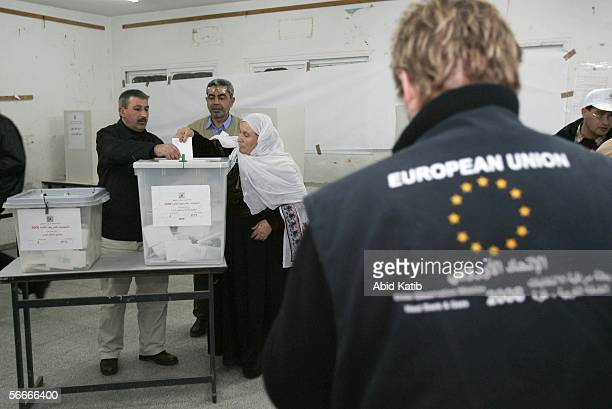 A member of a European Union mission to observe the parliamentary elections in the West Bank and Gaza monitor Palestinians as they vote for the...